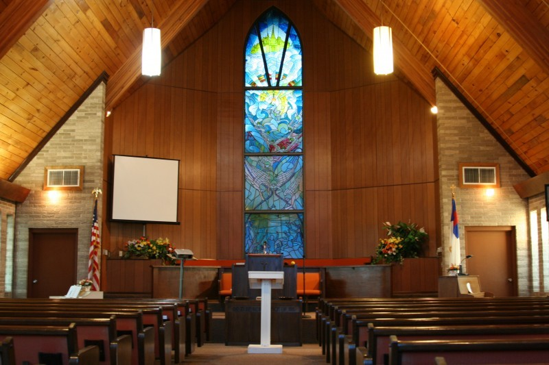 Picture of the Pulpit and interior stained glass